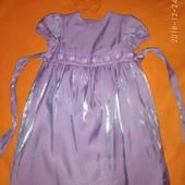 Нарядное платье лилового, красивого цвета.