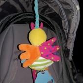 Нужная вещь на коляску птичка-грызушка
