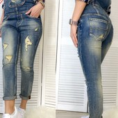 Крутезний джинсовий комбінезон.Розмір 30