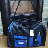 Дорожная сумка с ручкой на плечо, три отделения на молнии.