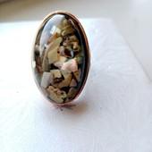 кольцо внутри ракушки