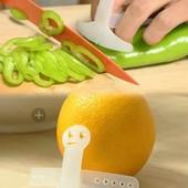 Забавный смайлик.кухонный инструмент,который бережёт пальцы при нарезке.1шт.