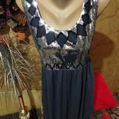 Эксклюзивное серое с поедками трикотажное платье стречь новое.Вискоз.Tammy. Размер указан 16.