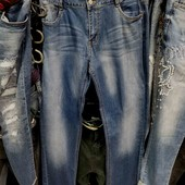 Новые стрейчевые  джинсы р. 32, поб 52 см,  пот 42 см.  Высокая талия