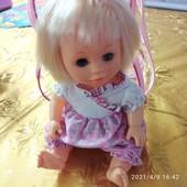 Музыкальная кукла в рюкзаке. Состояние отличное.