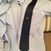 Новый, отмененный, лаконичный шелковый галстук бренда SRL (Италия).