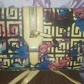 Симпатичная лаковая сумочка