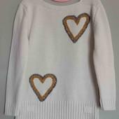 Білий жіночий светр.